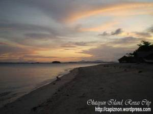 Sunset view at Olutayan Island overlooking Napti Island and Roxas City