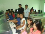 Mr. Allan Hernminigildo with Computer Programming Teacher Charles B. Almonguera Jr and the participants in the seminar workshop